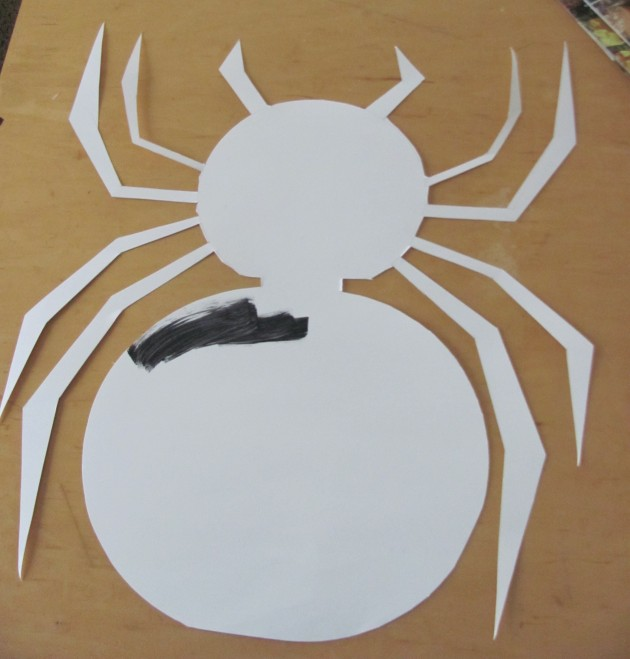 Fully cut out spider, now to finish painting it black.