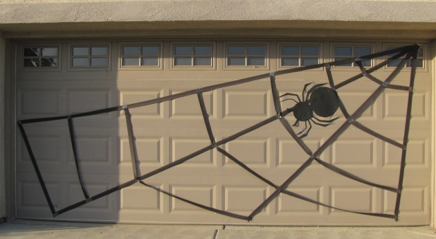 Spider up on the garage web, but my husband thought it needed another main branch up with the cross branches. So that's what we did.