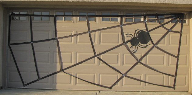 Here is my finish look at my spider web for the garage door. My original spider body I had made didn't look very good so I made one from a poster board and I think it actually looks much better so this is what we have. I Like it. I may have to retape some of the streemers to the door but that shouldn't too much more trouble.